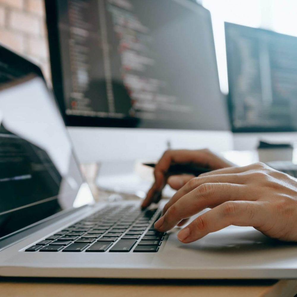 contemporary-website-developer-man-typing-and-writing-code-for-program-website