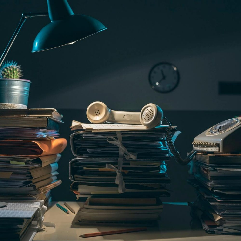 vintage-style-desk-with-lots-of-paperwork